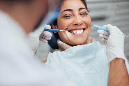 Woman smiling during dental checkup