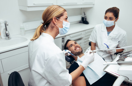 Dental doctor treating patient in clinic