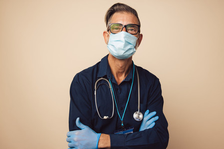 Portrait of a male doctor on protective mask and gloves