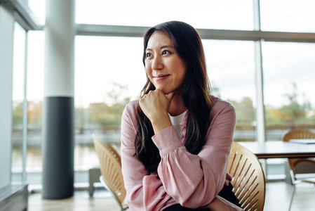 Woman in business casuals sitting in office