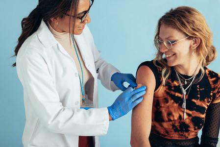 Woman getting flu shot in clinic
