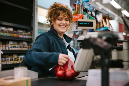 Cashier scanning grocery products at checkout