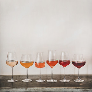 Various shades of Rose wine in stemmed glasses  square crop