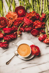 Cup of espresso coffee or cappuccino and ranunculus flowers