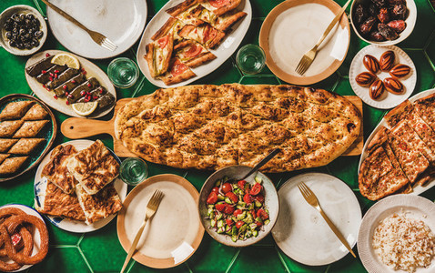 Muslim Ramadan iftar family dinner with Turkish foods copy space