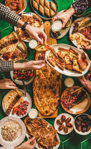Muslim traditional Ramadan iftar family dinner table with Turkish cuisine