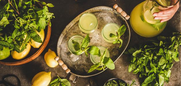Fresh homemade citrus lemonade in tray over grey kitchen counter