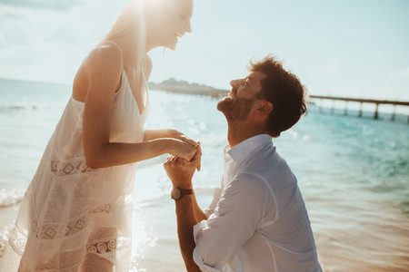 Couple getting engaged on tropical island