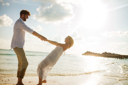 Romantic couple enjoying on a beach holiday