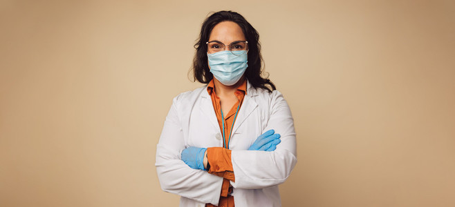 Female doctor with face mask and gloves