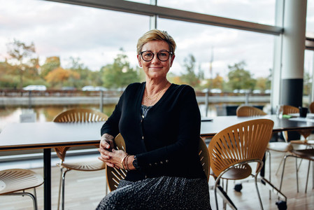 Successful senior businesswoman in office