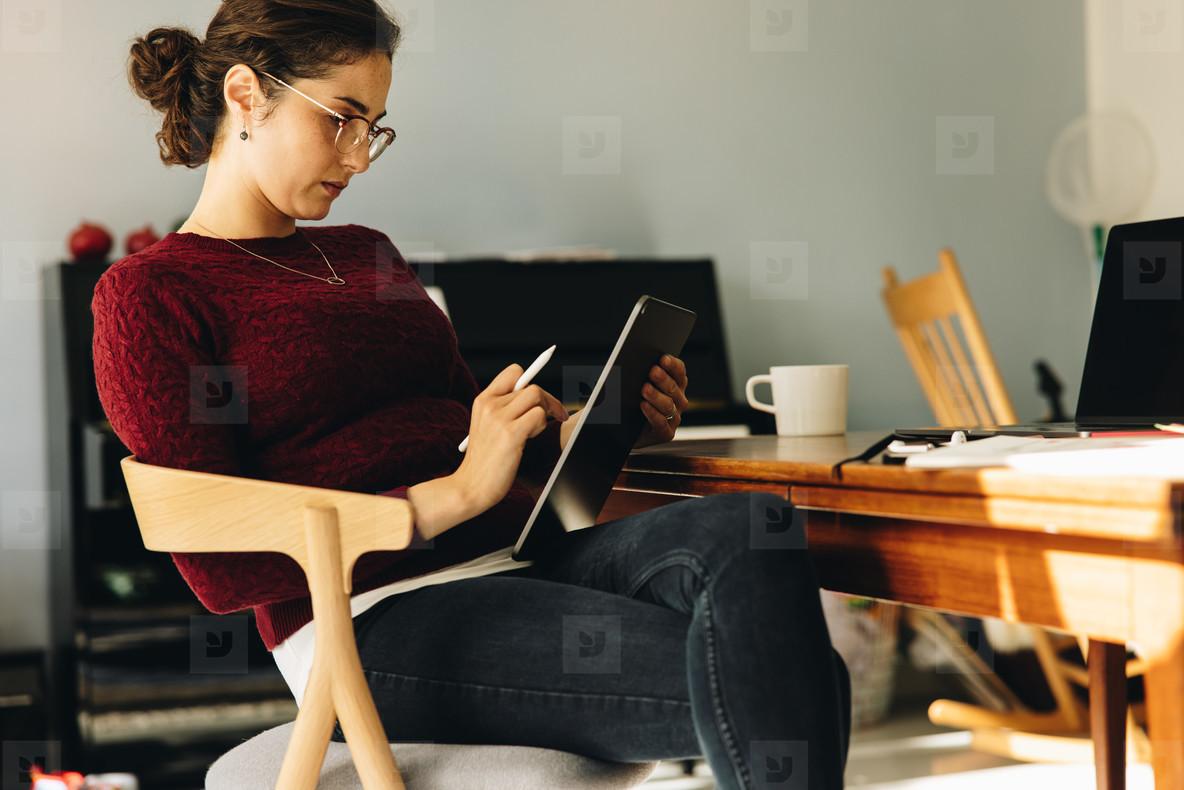 Female designer using graphic