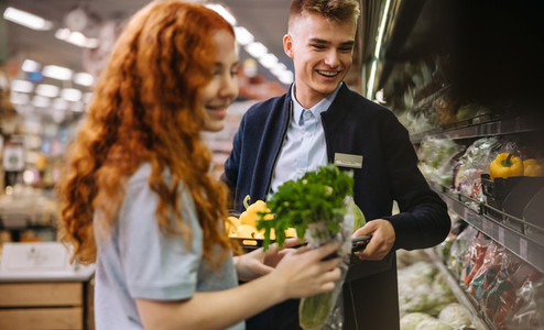 Employees packing fresh produce in supermarket