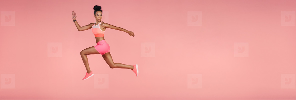 Woman working out on panoramic background