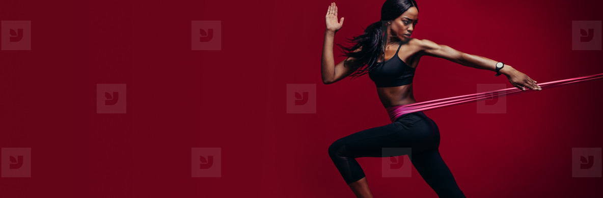 Strong woman exercising with a resistance band