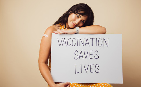 Attractive female with vaccination saves lives banner