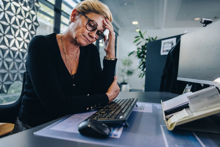 Female professional having stress at work