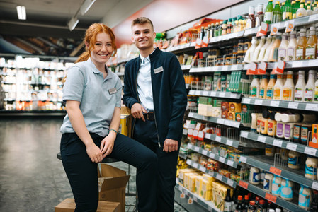 Portrait of grocery store assistants