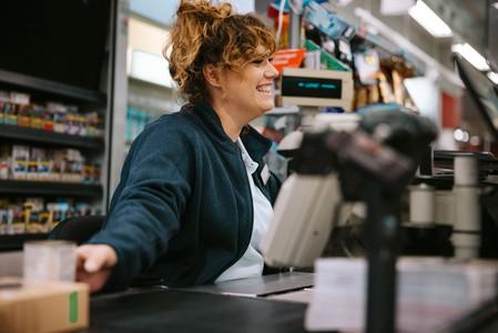 Friendly supermarket cashier