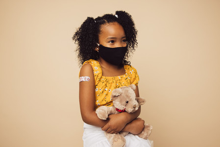 Small girl after getting vaccine