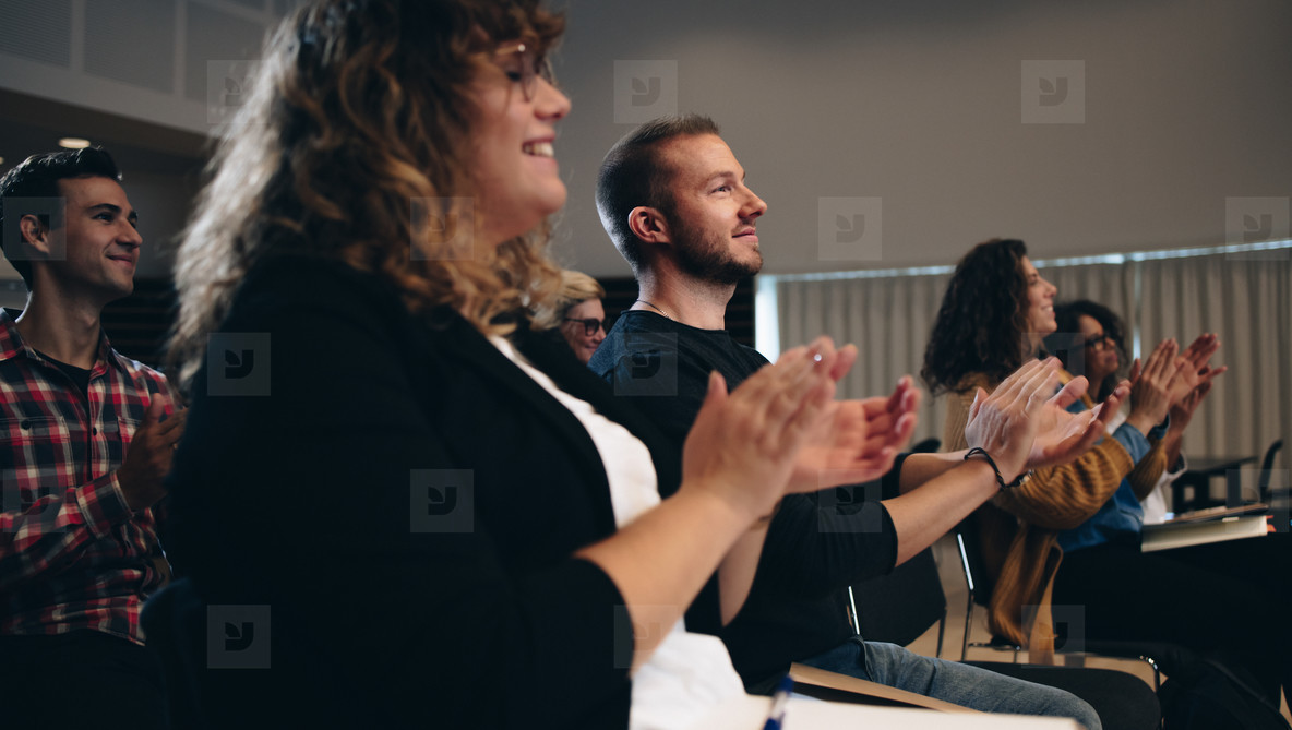 Business people applauding in a summit