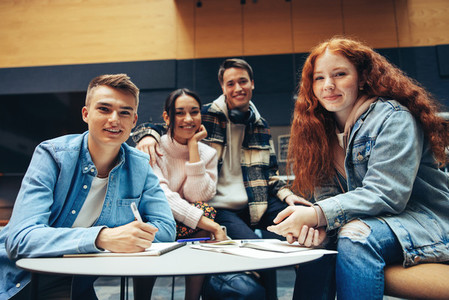 Students doing group studies in high school