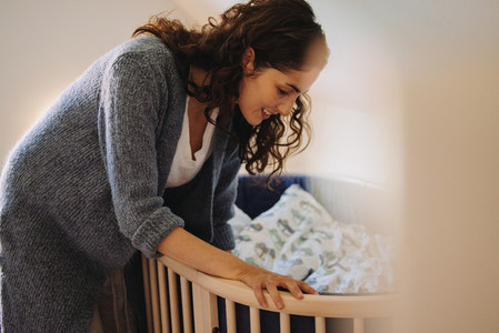 Loving woman putting her baby