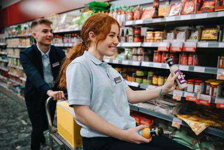 Supermarket employees having fun while working