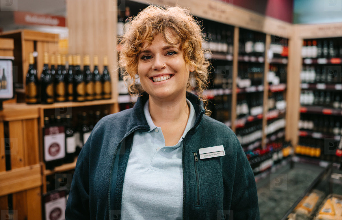 Friendly wine store worker