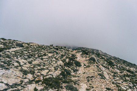 cloudy day with fog in the mountains of the natural park of the ports  in tarragona spain