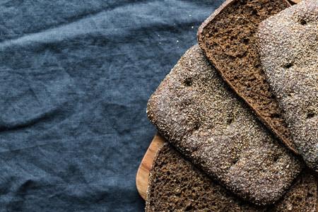 Rye sliced bread on a dark table