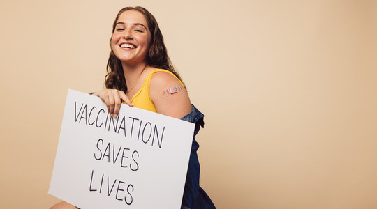 Pretty woman with Vaccination saves lives banner