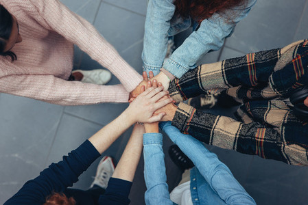Young People showing unity by hands