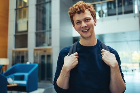 Smiling student in university campus