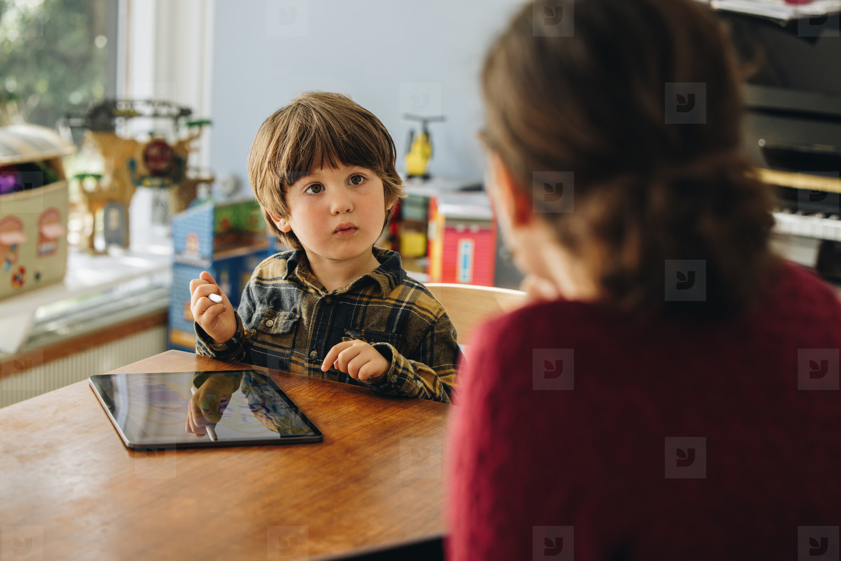 Kid using digital tablet