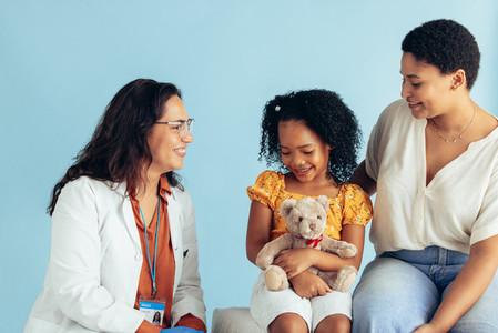Pediatrician examining a patient