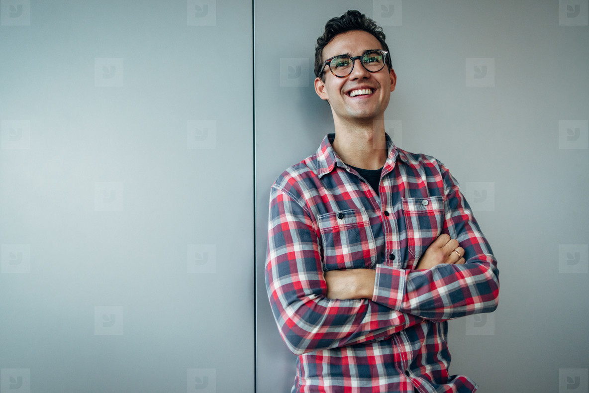 Young businessman looking away and smiling