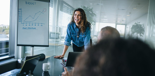 Female professional smiling during a business presentation