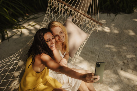 Friends on a holiday capturing memorable moments