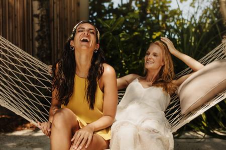 Women friends relaxing in a hammock on a holiday