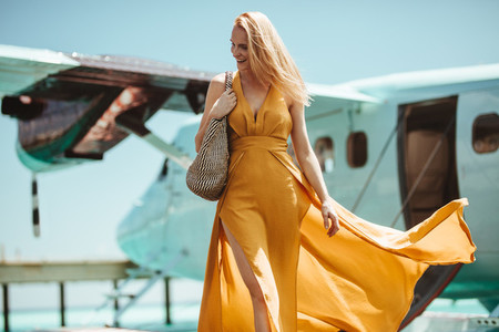 Woman on a holiday in a fashionable maxi dress