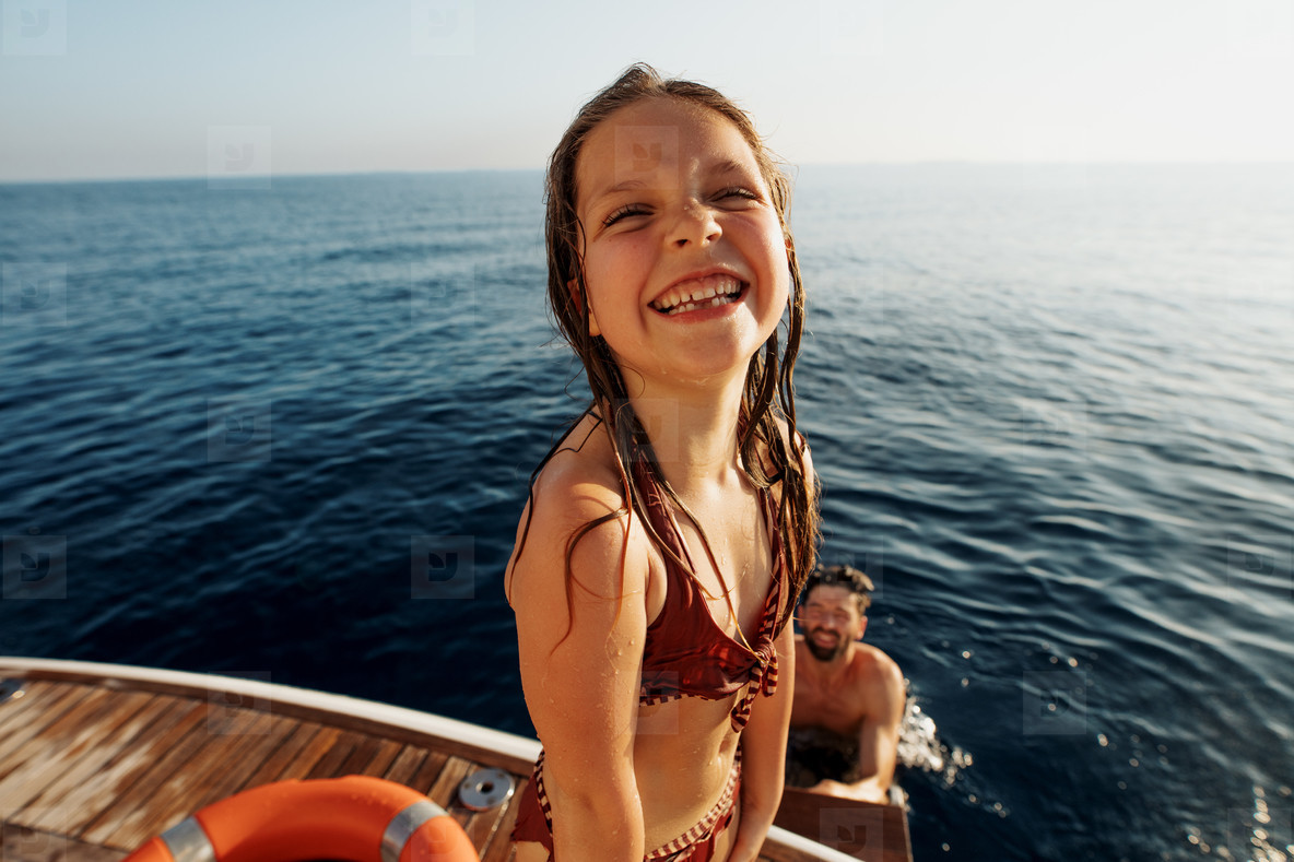 Kid enjoying vacation on a yacht with family