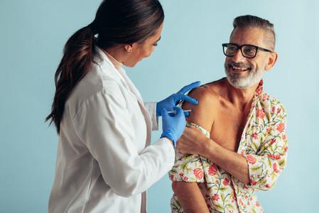 Doctor giving flu shot to patient
