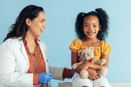 Doctor with small girl