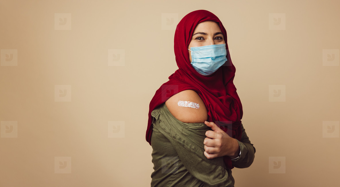 Muslim woman in hijab received a vaccine