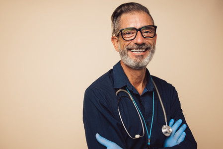 Positive general practitioner smiling at camera