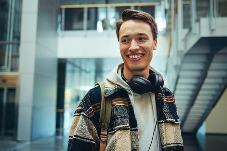 Male student in high school with headphones