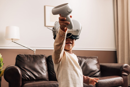 Kid playing virtual reality games at home  Little boy having fun with VR