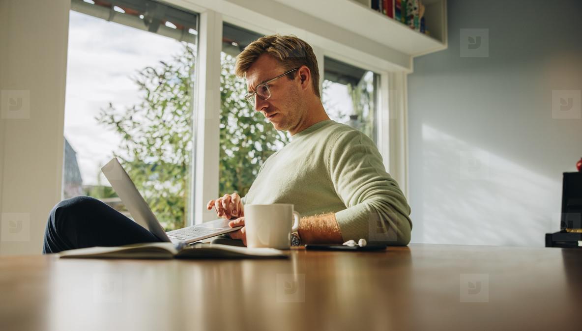 Caucasian man sitting at home