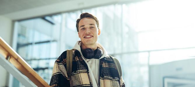 Confident male student in college campus